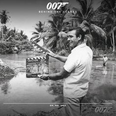 Sean Connery (James Bond) operates the clapperboard on the Jamaican set of DR. NO (1962)