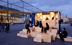 HASSELL | Projects - Chasing Kitsune | boxes fitted to the interior of a food truck become the seating for people