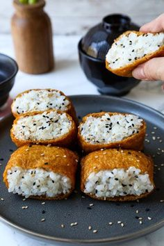 Childhood memories come flooding back every time I bite into an inari sushi pocket! This traditional Japanese dish is both sweet and savory and can be served as a snack, as part of a sushi Easy Japanese Recipes, Japanese Dishes, Vegan Japanese Food, Japanese Side Dish, Japanese Drinks, Japanese Desserts, Japanese Sushi, Japanese Sweet, Japanese Art