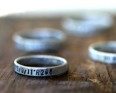 "customized ring that can be printed with any text. i really want a ring that says ""if i cannot fly, let me sing"" because i am too chicken to get it on a tattoo."