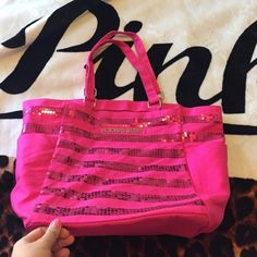 Just marked down ⭐️ vs bag need gone! Good condition Victoria's Secret sequin hot pink tote. Does have some marks on it as shown in photo. Marks on both sides towards the bottom Victoria's Secret Bags Totes