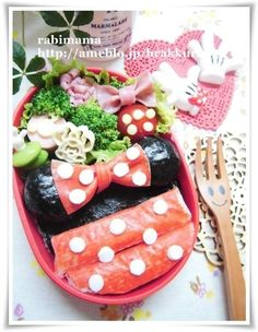 Cute Minnie Mouse bento box (made from rice, nori, & imitation crab)