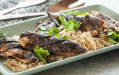 Grilled Spiced Sardines with Couscous // Never cooked fresh sardines before? This easy, super-tasty recipe featuring aromatic spices is a great introduction. We love it as a main dish, but you could also serve it as a starter for 6 people. Ask your fishmonger to prepare the sardines for you.