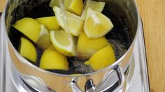 The favorite method for cleaning stainless steel pots and pans. All it takes is a few cut up lemons and water. - Pro cleaners swear by this no-scrub trick! Stainless Steel Pot, Diy Kitchen Cabinets, Kitchen Cleaning, Kitchen Tips, Door Makeover, How To Make Diy, Steel Doors, Cleaning Hacks, Cleaning Solutions