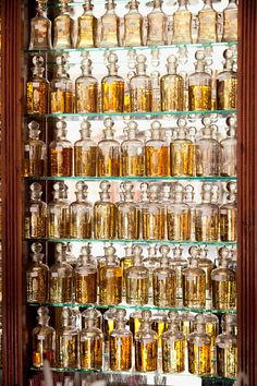 Perfumes stacked on shelves at a shop in the medina of Marrakech, Morocco