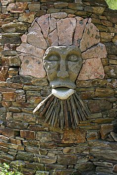 Stone face with a beard in a wall, France - photo by Kurt Pertl (einhorn*), via Flickr