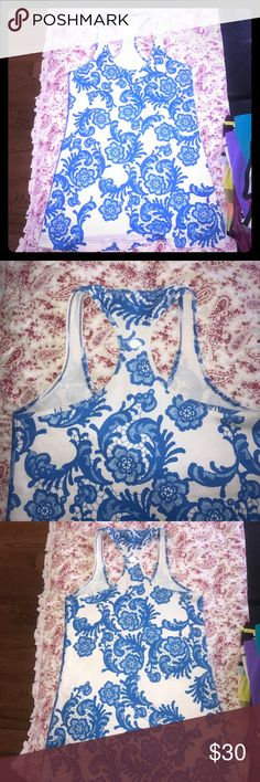 Lululemon size 8 Cool Racerback tank blue lace Adorable blue floral Lace pattern Cool Racerback tank in excellent condition. lululemon athletica Tops Tank Tops