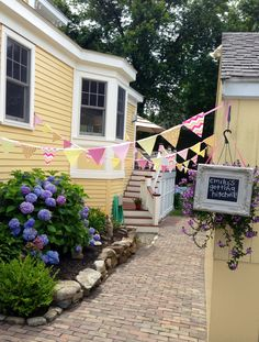 Flag banners to decorate the entrance to a backyard bridal shower.