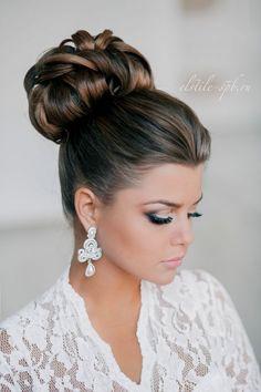 elegant top knot bun bridal updo wedding hairstyle