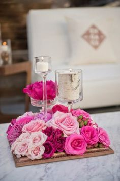 Low Centerpieces - Belle The Magazine... liking the different heights for the candle holders... could even make them plain wood with holes inset in the top