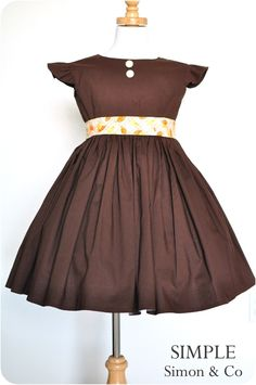 Flutter sleeve vintage twirl dress tutorial with fabric covered buttons and sash, so cute