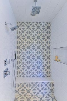Home Decor Ideas Wood A small walk-in shower is clad in white and gray mosaic cement tiles accented with a built-in shower bench flanked by walls clad in large white stacked tiles fitted with a shower niche. Small Shower Remodel, Small Bathroom With Shower, Shower Niche, Small Showers, Diy Shower, Shower Doors, Small Bathrooms, Bathroom Showers, Shower Tiles