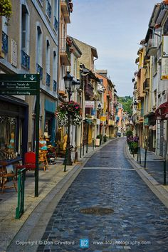 One of the quaint streets in Lourdes France...Lourdes is a small market town lying in the foothills of the Pyrenees, famous for the Marian a...