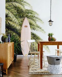 Styling by Fiona Michelon for homes+ magazine with our wall mural Leaf Love.