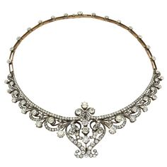 A Victorian Scroll Design Diamond Necklace. England, Victorian. Silver and silver gilt set with old cut diamonds. Used to be a tiara and transformed into a necklace. The added part from a later date. For more detailed information, please contact Massoni. 19th century