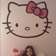 Her Hello Kitty room. Found clip art online, saved it to laptop. Borrowed a projector from work and projected image onto wall. Traced with a pencil and painted.