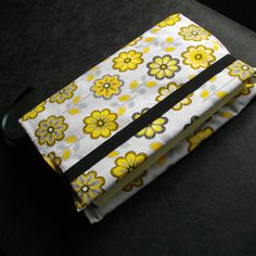 Fabric book cover with elastic.