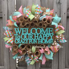 This cheerful burlap deco mesh welcome wreath will give guests a warm welcome into your happy, crazy, and fun home! This is a very full wreath measuring 24 in diameter. The wreath is constructed of natural jute burlap deco mesh. Aqua, coral, lime green, and burlap wired ribbons
