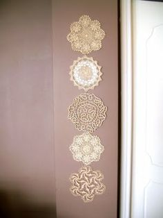 Display of doilies  http://afewprettythings.blogspot.com/2009/10/how-to-make-wall-hanging-from-doilies.html