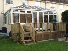 Decking with conservatory - better with white railings? Conservatory Extension, Sunroom, Shed, Extension Ideas, Conservatories, Outdoor Structures, House Design, Railings, Greenhouses