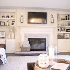 Lime wash with white mantle, sconces.