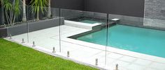 This is the kind of pool that I want for my home. I especially like the glass fence around the pool. I would like my pool to extend into my home though I wonder if that is possible. Glass Pool Fencing, Glass Fence, Pool Fence, Backyard Fences, Garden Fencing, Pool Pavers, Brick Fence, Front Yard Fence, Pallet Fence