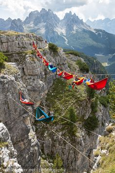 """"""" On September 9, 2014, 22 people nestled into 16 hammocks for one epic chillout session. Photographer Sebastian Wahlhütter was on hand to capture the day's events which took place on Monte Piana, in..."""