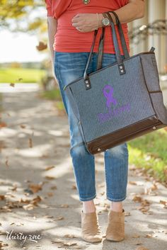 October is Domestic Violence Awareness Month. Go purple to show your support for strength and survival, as proudly carried here with our Thirty-One Cindy Tote in Denim Herringbone with Purple Care Ribbon embroidery.  For every ribbon purchased 31 cents will be donated to Thirty-One Gives to support our mission to empower women and girls and strengthen families.www.mythirtyone.com/angiebailey