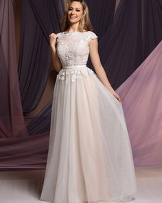 It's all about color! This informal wedding dress comes in this beautiful blush color and ivory.