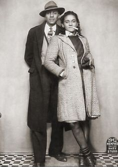Bonnie & Clyde, 1942 Sharp dressed couple sitting for a full length portrait shot taken at the Daisy Studio. Memphis, TN, Vintage African American photography courtesy of Black History Album.