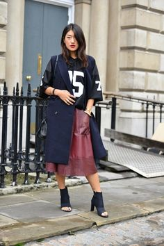Sporty approach to styling this full leather skirt.
