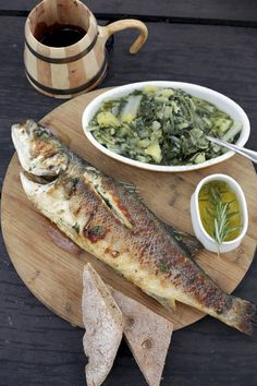 Dalmatian traditional delicacies, grilled Mediterranean seabass and chard | Dalmatian Ethno village near Šibenik, Croatia