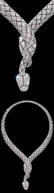 A diamond serpent necklace,  in the form of a snake, the platinum body finely set with old  brilliant cut diamonds in a bombé scale pattern, its  body entwined to form the neck.  Paris, circa 1919. Attributed to the Lavabre workshop. Lavabre supplied Cartier Paris with diamond set jewels and a necklace of identical design made by  Lavabre for Cartier is held in the Cartier Collection.