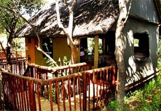 In the thriving Waterberg bushveld, accommodation options at Mabalingwe Nature Reserve are as diverse as the flora and fauna of its surrounds. The reserve is only an hour from Johannesburg, making it a great weekend break for city slickers. City Slickers, Weekend Breaks, Nature Reserve, Hotels And Resorts, Garden Bridge, Gazebo, Outdoor Structures, Cabin, House Styles