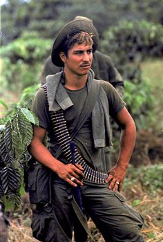 {198} A U.S. infantryman of the 199th Light Infantry Brigade is seen on a joint Vietnamese/U.S. patrol near coffee and rubber plantations 50 miles northeast of Saigon, Nov. 29, 1969. (AP Photo/Horst Faas)