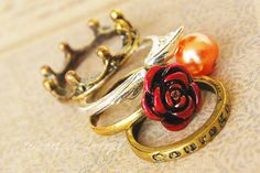 Gryffindor house rings -- Which includes Ron's crown, Harry's snitch, and Hermione's red rose.