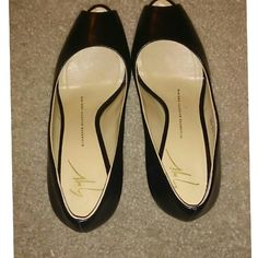 Stunning Giuseppe Zanotti Black Peep Toe Heels Well kept, great condition! These shoes are not only beautiful but they are very comfortable. Worn, but still in great shape and clean. 4 inches Giuseppe Zanotti Shoes Heels