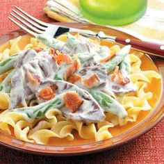 """Blue Cheese Stroganoff Recipe -Doris Heath of Franklin, North Carolina shared this out-of-the-ordinary Stroganoff, made with snap peas and a mild blue cheese sauce. """"You can use any kind of pasta you wish…even leftovers,"""" Doris notes."""