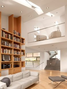 Muir Beach Residence by Jerry Kler Associate Architects- I really like the gaps in the bookcase where the wall is visible. Can still use the spaces but creates visual interest.
