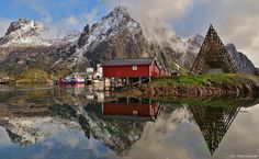 Rorbuer ( boat she's style hotel cabins) fish drying rack (the big triangles), and beautiful nature in Lofoten's Svolvær, Norway