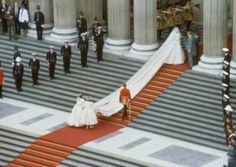 Lady Diana Spencer getting ready to enter St.Paul's Cathedral on her wedding day. Her 25 foot train looking so incredible at it's full length.  A fairytale wedding to be sure.  July 29,1981.