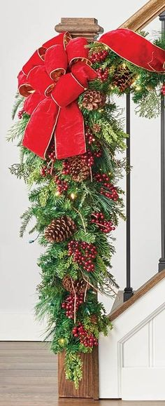 Set the holiday scene in an instant with a mixture of greenery that's amazingly full and realistic. Our Christmas Cheer Swag overflows with sprays of Scotch and pistol pine, noble fir, pine cones, variegated holly and ruby red berries.