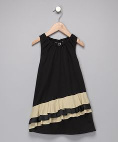 Great asymmetrical ruffle on this simple little dress.