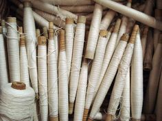 Wooden bobbins with white thread Yarn Thread, Thread Spools, Textiles, Bobbin Lace, Sewing Notions, Haberdashery, Vintage Sewing, Twine, Decoration