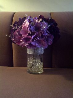 *USING THE EMERALD MARBLE PIECES* Centerpieces: 3 different color purple Hydrangeas, water-beads, rhinestone wrap I attached clear crystals in the flowers and I also had a purple LED light in the bottom of the water beads to illuminate the vase. Wedding Table, Diy Wedding, Wedding Events, Wedding Flowers, Dream Wedding, Weddings, Wedding Ideas, Purple Wedding Centerpieces, Party Centerpieces