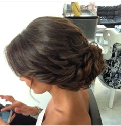 Low chignon, bridal effortless looking hairstyle, wavy brunette low bridal…