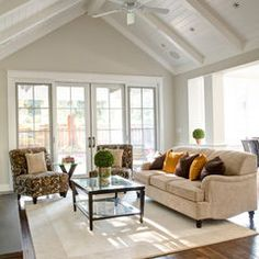 Beautiful living room with patio doors and glass topped coffee table!traditional family room by Allwood Construction Inc