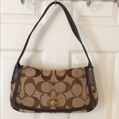 Coach 11257 Brown Tan Signature C Shoulder Bag Turn lock flap closure.  Back pocket.  Hang tag.  3 interior pockets (1 zips).  Good condition.  Lightly dirty.  Measures: 13.75x1x8x9.5. Leather jacquard. Coach Bags Shoulder Bags