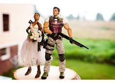Handmade (painted and decorated) cake toppers chosen by my husband!! (from Resident Evil- Chris & Sheva)