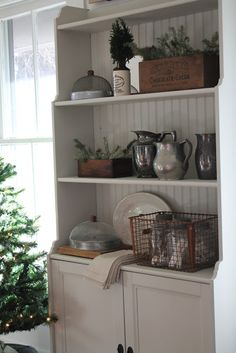 The sun is shining bright here today so I thought I would share some photos of my dining room all decorated for Christmas. Our farmhouse is . Farmhouse Interior, Farmhouse Decor, Farmhouse Style, Cottage Farmhouse, Cottage Style, Above Kitchen Cabinets, Cupboards, Cabinet Decor, Hutch Cabinet